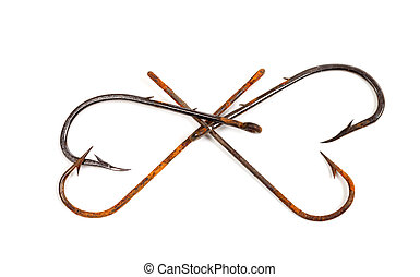 Old rusty fish hooks in form of hearts