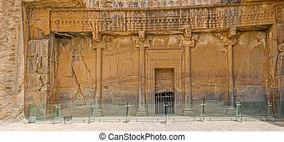Persepolis royal tombs facade - Royal tombs relief ruins on...