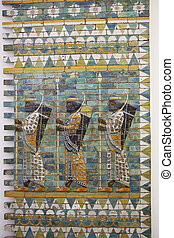 Three warriors on ancient wall from Babylon - Three warriors...