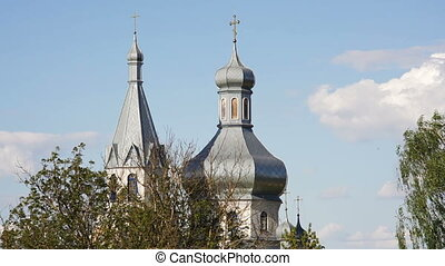 Domes of Orthodox Church against background of blue sky