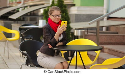 businesswoman at a table in a cafe