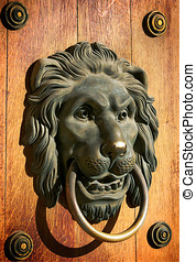 Lion head door knocker - A lion head, brass door knocker in...