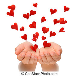 Flying hearts from cupped hands of young woman, Valentines...