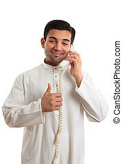 Happy ethnic businessman on phone - Happy ethnic mixed race...