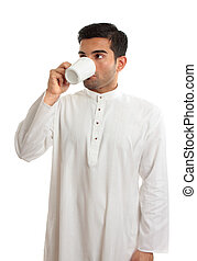 Arab man drinking coffee - An arab middle eastern man...