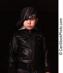 Boy in the image of a gangster rapp - Kid in leather jacket,...