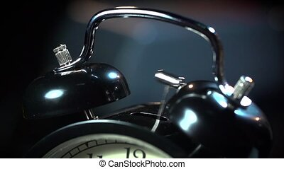 Ancient desktop alarm clock on a black background macro -...