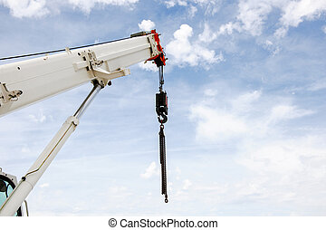 Powerful industrial crane against beautiful and blue sky