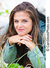 Smiling Young Woman Outdoors - Portrait of an attractive...