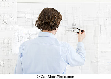 Revisions of a technical drawing - Engineer going over the...