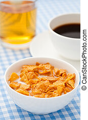 Breakfast cereal with milk, coffee and apple juice