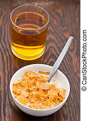 Breakfast cereal with milk and apple juice