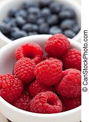 Fresh raspberries in a dish