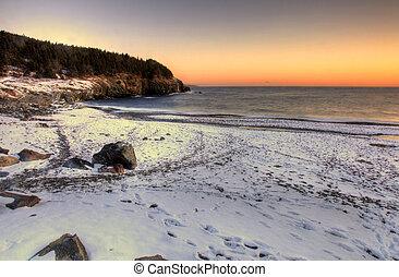 Winter beach - A snow covered beach at sunrise