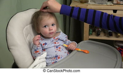Baby girl being fed yogurt - A 4k video made with a Sony...