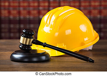 Mallet And Yellow Hardhat In Courtroom - Closeup of wooden...