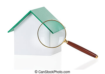 Closeup Of Magnifying Glass And House Model - Closeup of...