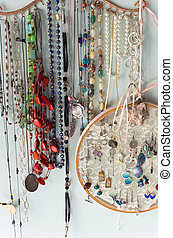 Jewelry and Finery Hanging Against - jewelry organizer...