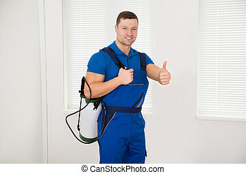 Confident Male Worker Carrying Pesticide Container