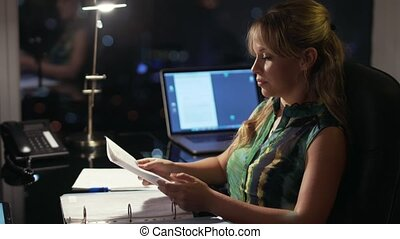 Businesswoman Working Late At Night With Tablet In Office -...