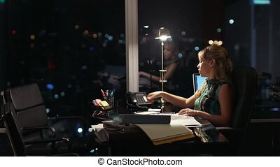 Businesswoman Working Late At Night Answering Phone Call -...