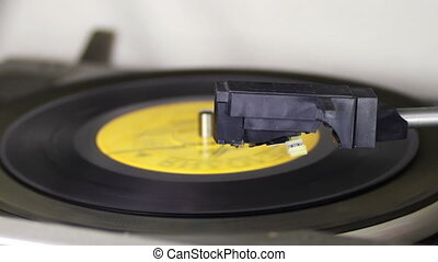 Old Vinyl Record Playing - Macro shot of old vinyl recording...