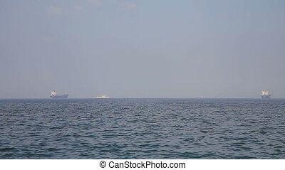 Trade ships in the bay - Cargo ship sailing in still water.