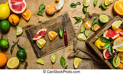 Sliced citrus fruits - grapefruit, orange, tangerine, lemon,...