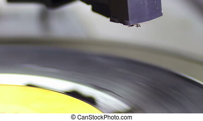 Turntable With Spinning Vinyl - Macro shot of old vinyl...