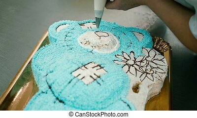 confectioner decorates a delicious cake