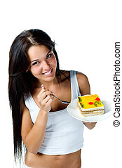 Attractive woman eating cake