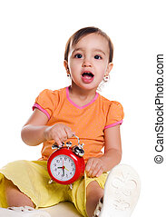 Cute little girl with the clock