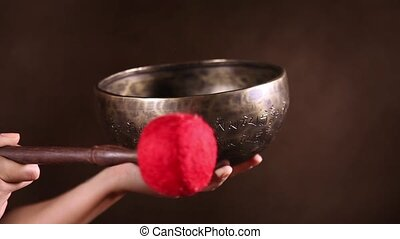 The sound of Tibetan singing bowl - Tibetan singing bowl in...
