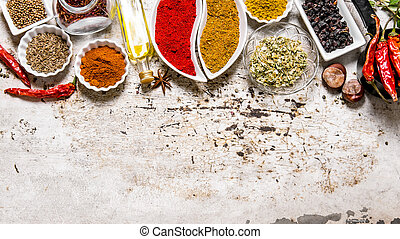 Large set of spices and herbs in the cups. On rustic...
