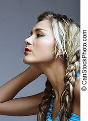 blond woman with braids - beautiful young woman in turquoise...