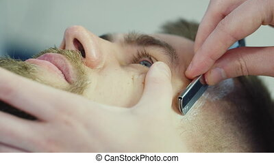 Mens hairstyling and haircutting in a barber shop or hair...