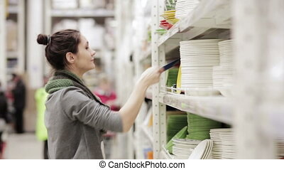 Young woman chooses dish in the supermarket - young woman...
