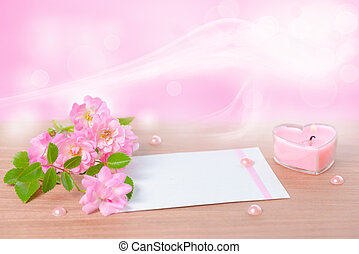 beautiful composition of delicate pink rose, heart shaped candle, card with place for text and pearl beads on wood background, closeup
