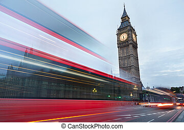 Big Ben and a red bus passing - Big Ben in the early morning...