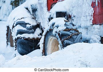 Tractor in the snow - Photo of an old red tractor in the...