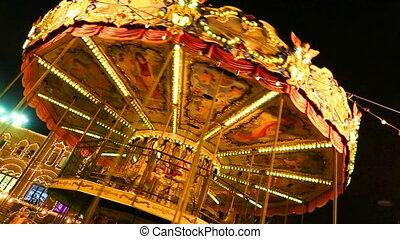 Festive carrousel with sparkling lights - MOSCOW, RUSSIA -...