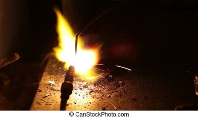 Close up process of welding metals in darkness -...