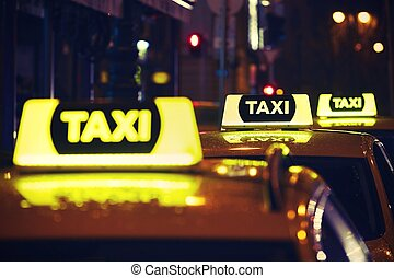 Taxi car at night - Taxi car on the street at night