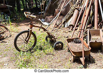 Tricycle and Wagon in Junkyard