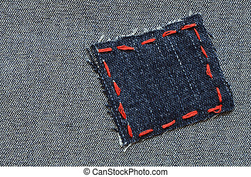 Jeans Patch - Patch with red thread attached on jeans...
