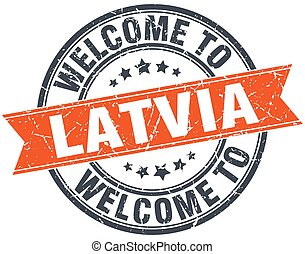 welcome to Latvia orange round ribbon stamp
