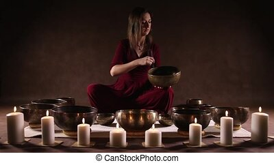 Tibetan singing bowl with sound - Woman playing a singing...