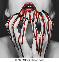 Woman in blood - Young woman touching her face in blood....