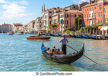 Gondola on Canal Grande in Venice, in a beautiful summer day...