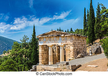 The Athenian treasury in Delphi, Greece in a summer day